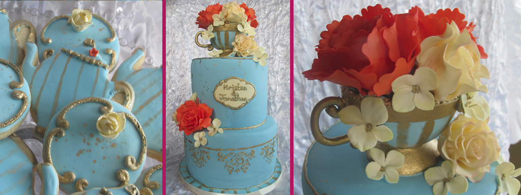 Vintage two tierd french blue cake with gold accented tecup filled with with cream and coral sugarflowers