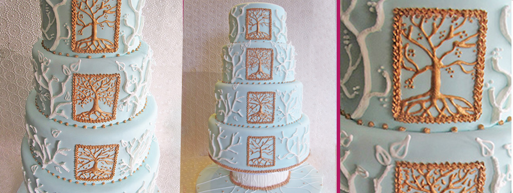 Light blue cake piped with the imagery of the four seasons