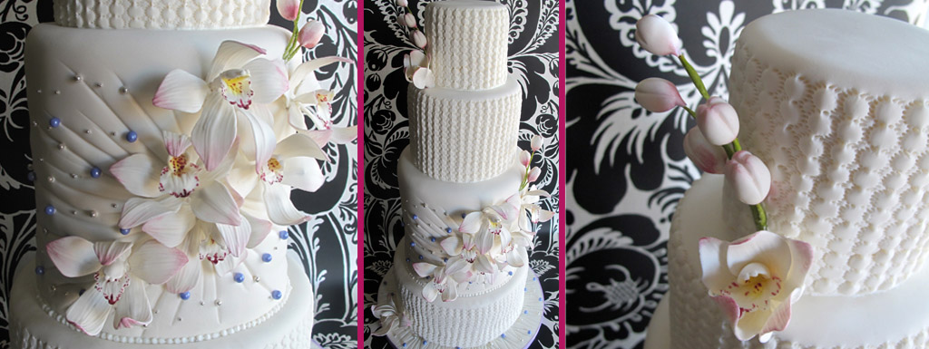 White cake with lavender accents and white orchid sugar flowers