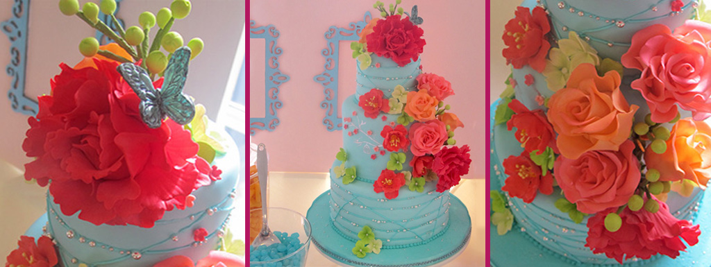 Coral flowers with aqua fondant covered cake