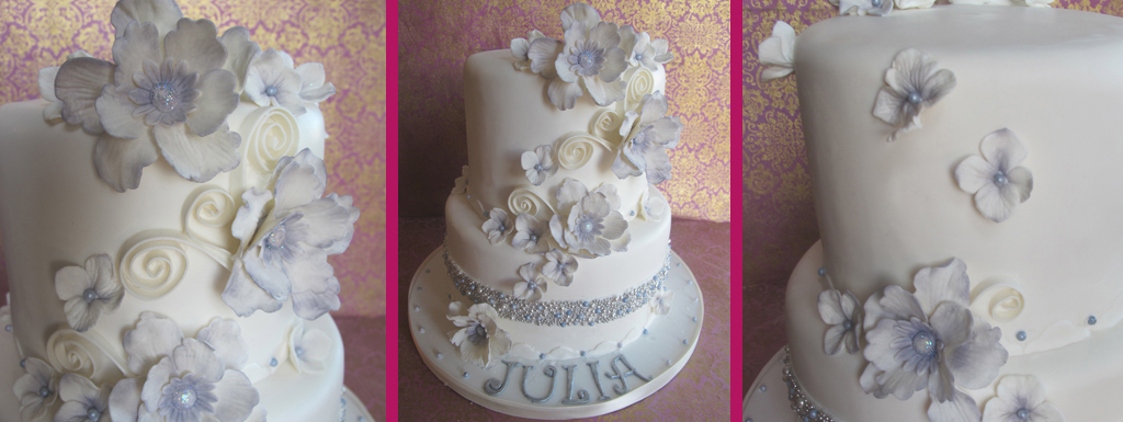 White cake with mauve accents and white fantasy sugar flowers
